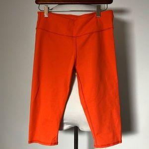 Red-orange Fabletics workout capris